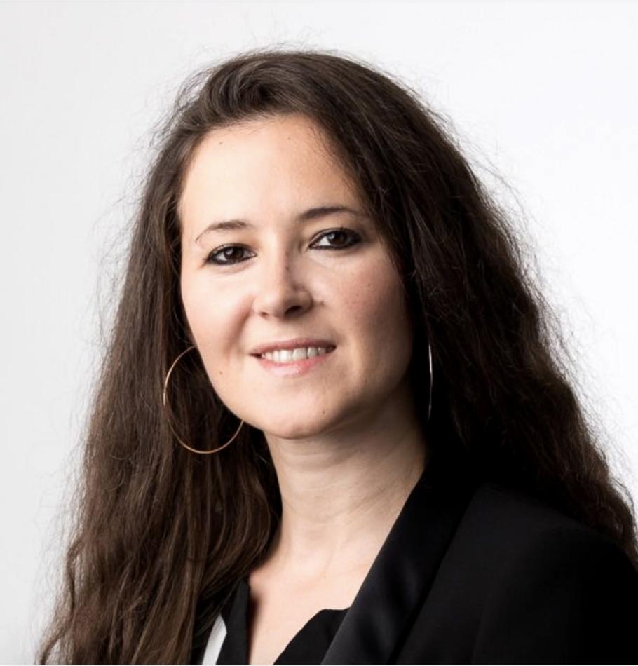 Portrait photo on white background of smiling role model Besiana Bandilli on We Shape Tech website