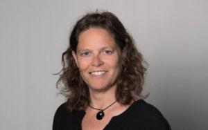 Portrait photo of smiling Bettina Rotzetter of role model