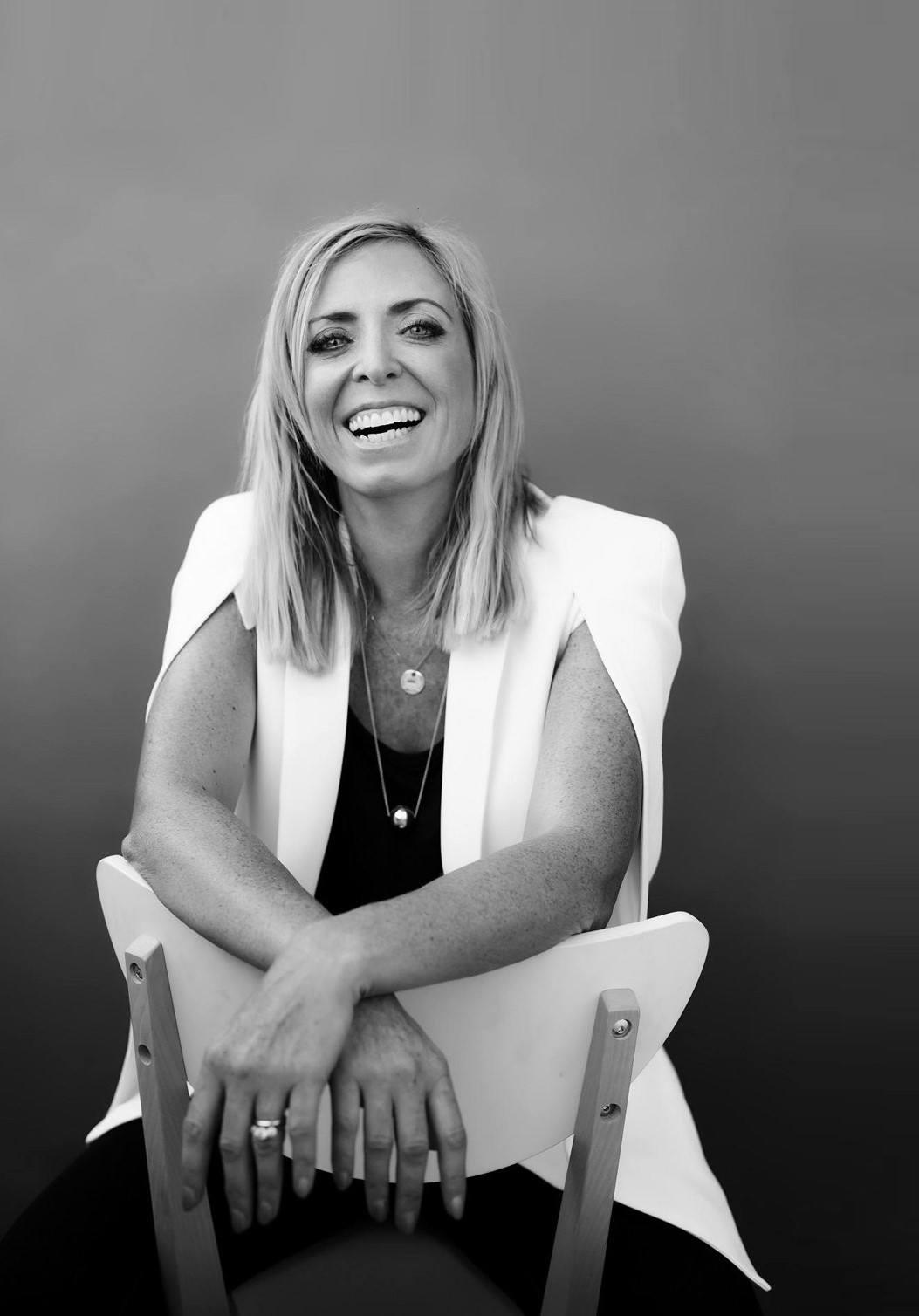 Portrait photo of smiling Janine Garner