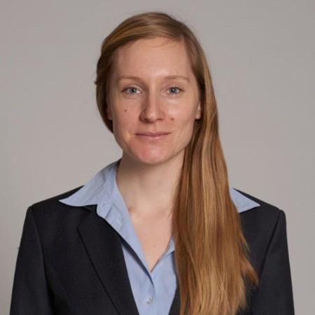 Portrait photo of Laura Kieser on light grey background of Role Model on We Shape Tech website.