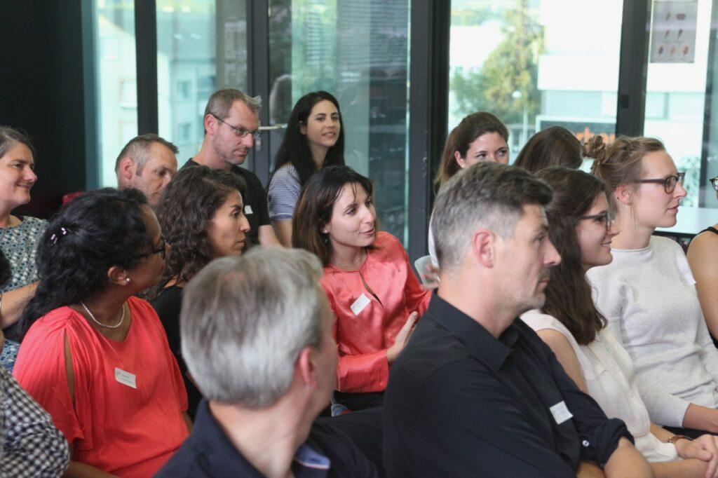 Audience at We Shape Tech event Leistung & Sport